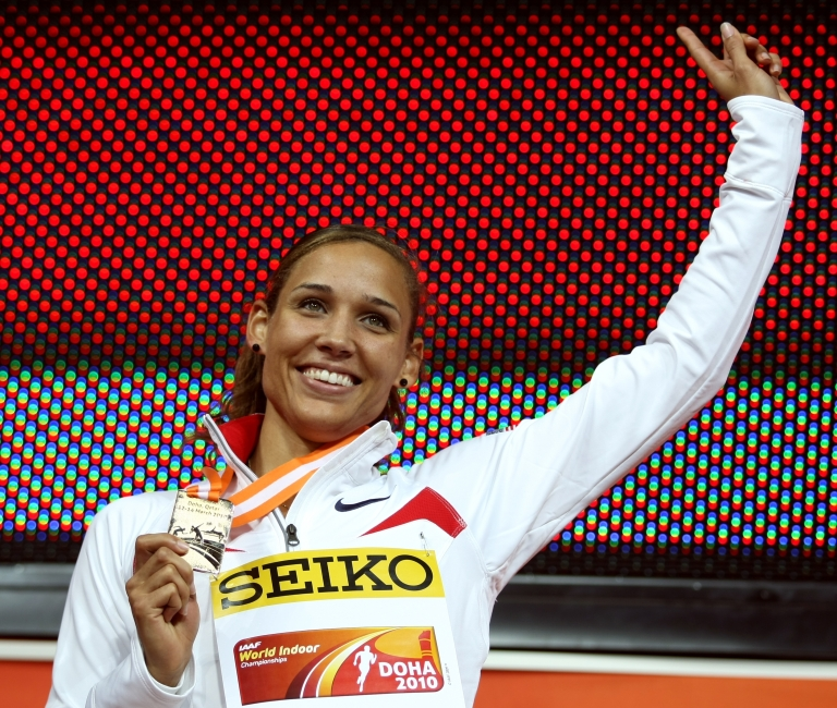 <p>Lolo Jones poses with her gold medal on the podium of the women's 60m hurdles final at the 2010 IAAF World Indoor Athletics Championships at the Aspire Dome in the Qatari capital Doha on March 13, 2010.</p>