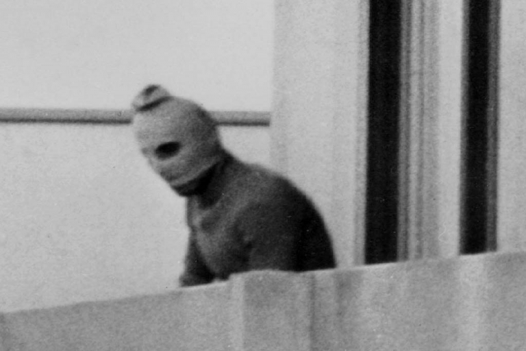 <p>MUNICH, GERMANY - SEPTEMBER 5, 1972: One of the eight Palestinian terrorists comprising the Black September group stands on a balcony of the Olympic village during a standoff after they kidnapped nine members of the Israeli Olympic team and killed two others September 5, 1972 in Munich, Germany. All the hostages were killed after a pitched battle at Munich Airport the next day.</p>
