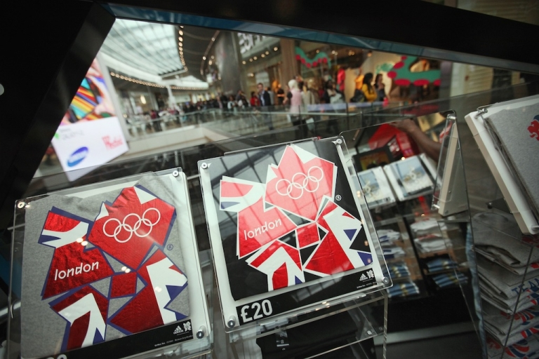 <p>T-shirts promoting the London Olympics go on sale in the newly opened Westfield Stratford City shopping centre adjacent to the Olympic Stadium on September 13, 2011 in London.</p>