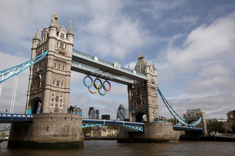 <p>LONDON, ENGLAND - JUNE 27:  A giant set of Olympic rings are displayed from Tower Bridge on June 27, 2012 in London, England. The rings weigh over three tonnes and measure over 25 metres wide by 11.5 metres tall; they will be illuminated in a light-show every evening during the Games.  (Photo by Oli Scarff/Getty Images)</p>