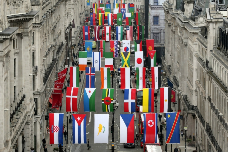 <p>Flags of 200 nations are displayed on Regent Street in London.  Crowds are expected to flock to the streets to catch a glimpse of the Olympics--for free.</p>