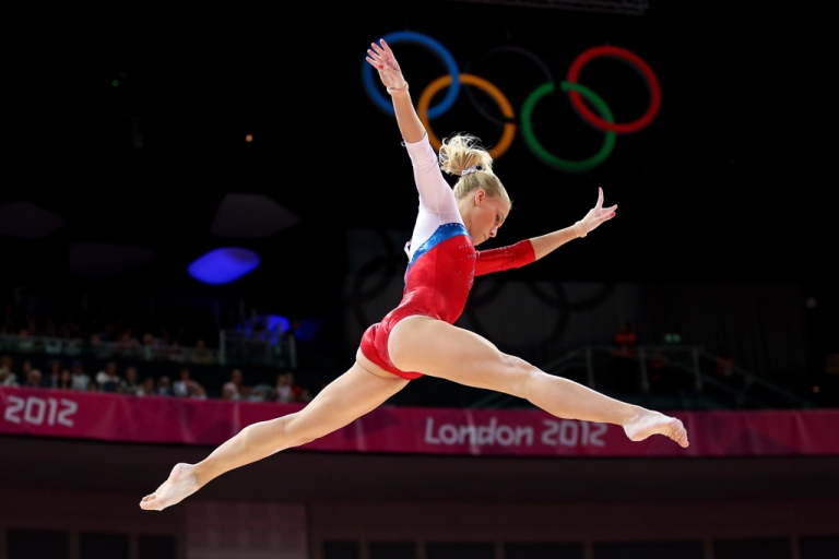 <p>Kseniia Afanaseva of Russia competes on the beam in the Artistic Gymnastics Women's Team qualification on Day 2 of the London 2012 Olympic Games at North Greenwich Arena on July 29, 2012 in London, England.</p>