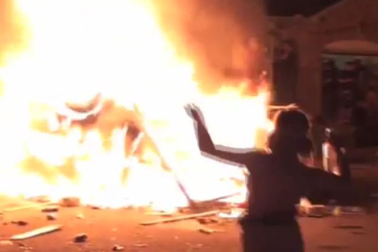 <p>Students dance around a burning TV news van Saturday night in London, Ont. Police arrested 11 after about 1,000 set vehicles ablaze and hurled rocks and bottles at police and firefighters.</p>