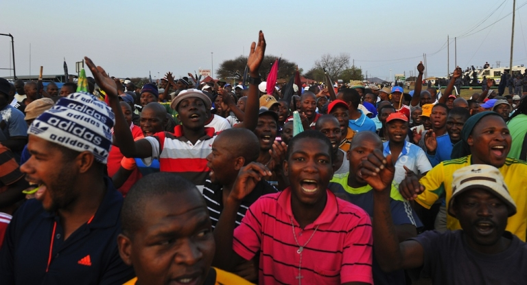 <p>Striking mine workers in South Africa celebrate after receiving a 22 percent pay increase from London-listed Lonmin on September 18, 2012.</p>