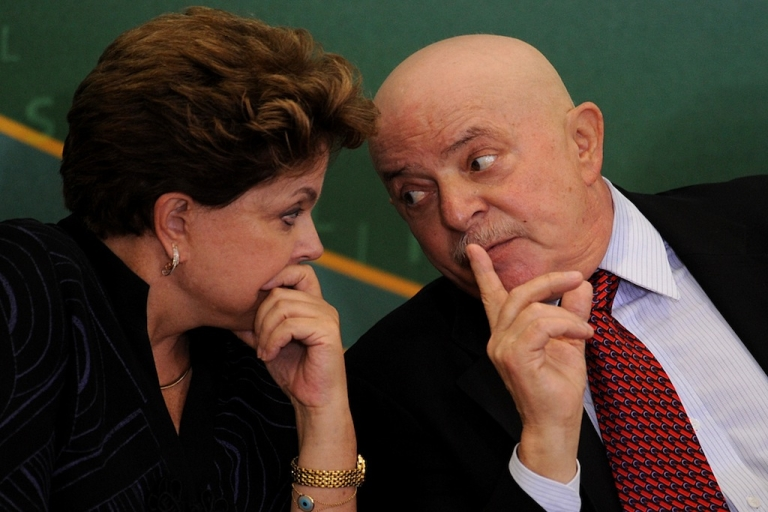 <p>Brazilian former-President Luiz Inacio Lula da Silva talks with President Dilma Rousseff, during a ceremony at Planalto Palace, Brasilia, Brazil, on January 24, 2012. Lula was without his trademark beard after undergoing treatment for larynx cancer.</p>