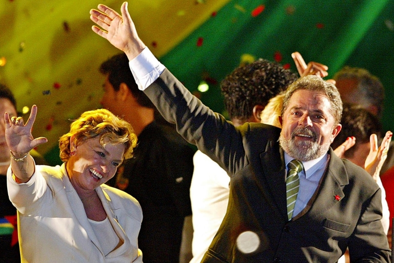 <p>Luiz Inacio Lula da Silva, right, and his wife Marisa wave to supporters Oct. 28, 2002, after Lula won Brazil's presidential election with a record 52 million votes, or over 60 percent of the total. Campaign marketers had helped transform his image from radical unionist to fatherly leader.</p>