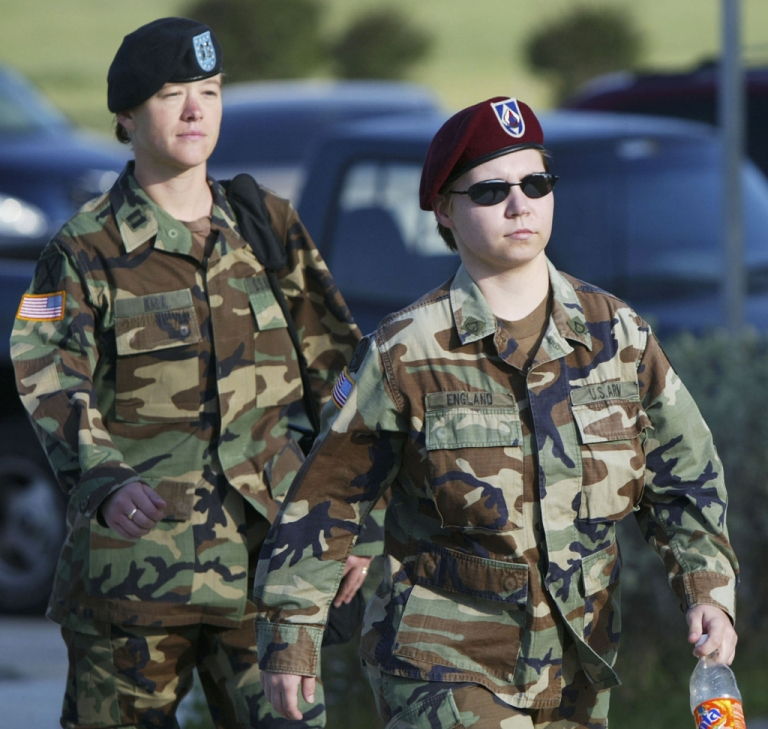<p>Lynndie England (R) walks towards the court accompanied by one of her defense team members, Capt. Katherine Krull, to begin an Article 32 investigation on May 24, 2005 at Fort Hood, Texas. Lynndie said in an interview Monday that she is still not going to apologize for her treatment of prisoners at Abu Ghraib in Iraq.</p>