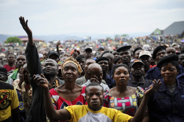 <p>Residents of Goma react as they listen to M23 rebel group spokesman at the Volcanoes Stadium in Goma, in the east of the Democratic Republic of the Congo, on Nov. 21, 2012. Lt.-Col. Kazarama addressed the population of Goma in an attempt to calm and reassure the civilians following the fall of the city to M23 rebels this week.</p>