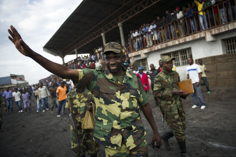 <p>Spokesman of the M23 rebel group Lieutenant-Colonel Vianney Kazarama waves at a crowd as he arrives at the Volcanoes Stadium in Goma, in the east of the Democratic Republic of the Congo, on November 21, 2012. Lt.-Col. Kazarama addressed the population of Goma today in an attempt to calm and reassure the civilians following the fall of Goma to M23 rebels yesterday.</p>