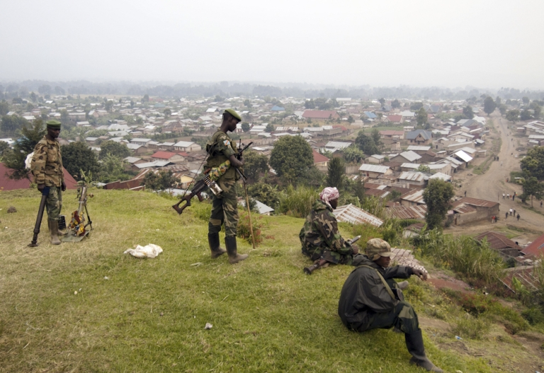 <p>Rebels of the M23 group man their position on a hill overlooking Bunagana, a town near the Ugandan border on July 8, 2012. Mutineers from the Democratic Republic of Congo on Sunday seized control of three towns in the country's eastern Nord-Kivu province, an AFP correspondent reported today. The rebels, known as M23, took Rutshuru and the towns of Ntamugenga and Rubare, less than 10 kilometres away on the road to the provincial capital Goma, shortly after 12:00 pm local time.</p>