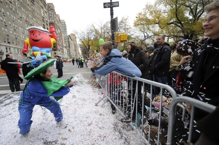 <p>Children throw confetti during the 84th annual Macy's Thanksgiving Day Parade in New York Nov. 25, 2010.</p>