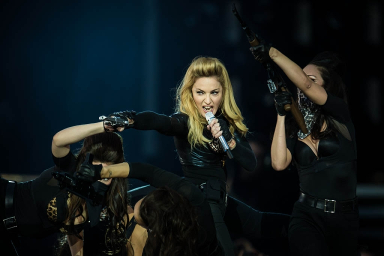 <p>Madonna angered anti-gay activists in Russia by passing out pink armbands at an August 9th concert in St. Petersburg. The singer is being sued for $10.5 million for promoting homosexuality to minors.</p>