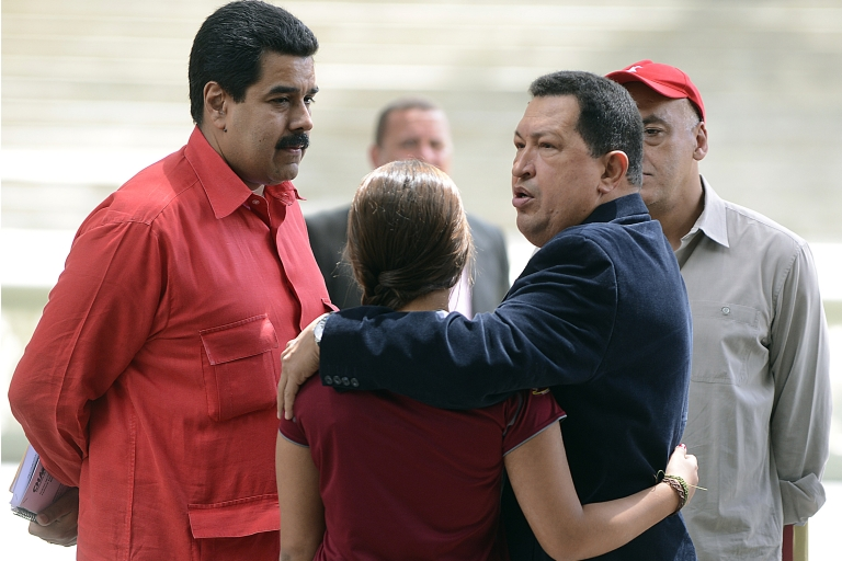 <p>Venezuelan President Hugo Chavez, right, hugs his daughter Rosa Ines as he speaks with Nicolas Maduro, his No. 2 who he said should be first to succeed him.</p>