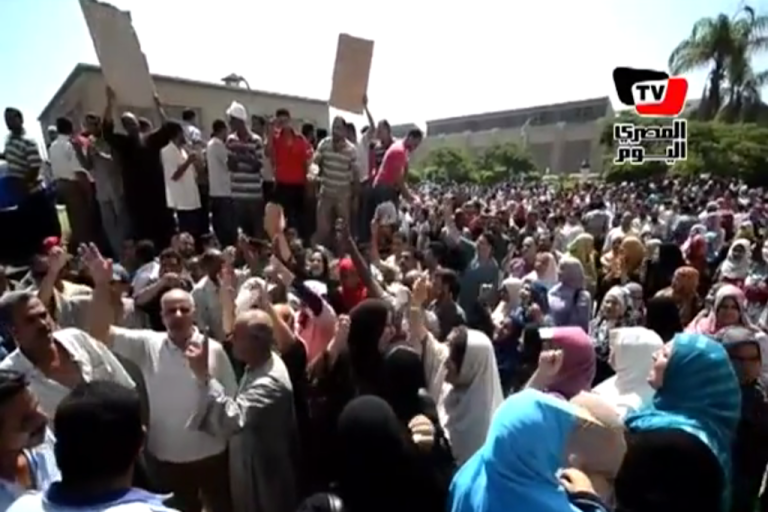 <p>This screenshot from Egyptian TV shows massive crowds protesting in the Nile Delta city Mahalla, where thousands of textile workers went on strike on July 19, 2012.</p>