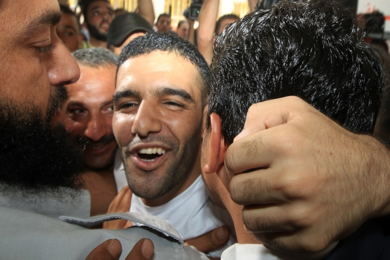 <p>Mahmud Sarsak (C), a Palestinian football player, staged a hunger strike for nearly three months while in Israeli jail. He is greeted by relatives and supporters as he arrives at the Al-Shifa hospital in Gaza City on July 10, 2012, after his release from Israeli prison. Sarsak staged a hunger strike of nearly three months to protest his detention without charge under Israel's 'unlawful combatants' law. His detention order was due to expire or be renewed on August 22.</p>