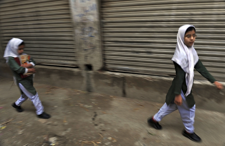 <p>In this picture taken on March 25, 2010, Pakistani girls walk to school in Mingora, the capital of Swat Valley.</p>