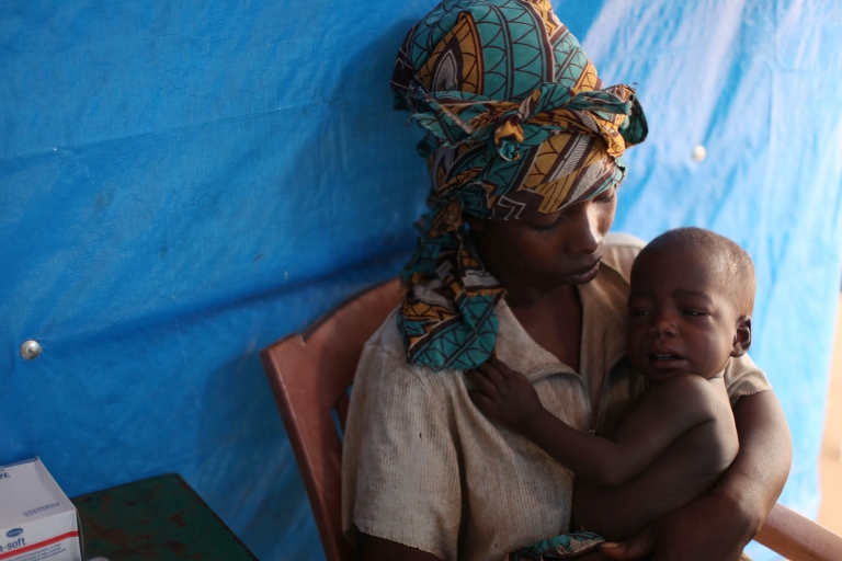 <p>A Congolese woman and her malarial child speak with a doctor at the Makpandu refugee camp outside Yambio, south Sudan, on Jan. 14, 2011.</p>