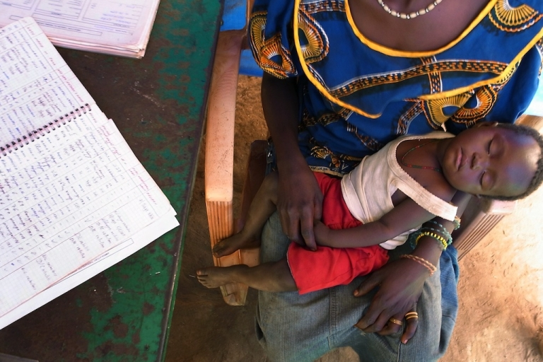 <p>A new report by the World Health Organization announced that malaria deaths have decreased by more than 20 percent.  In this photo a Congolese woman and her child — sick with malaria — speak with a doctor with Doctors Without Borders (Medecins Sans Frontieres) at a refugee camp in Makpandu, outside of the town of Yambio in South Sudan on Jan. 14, 2011.</p>
