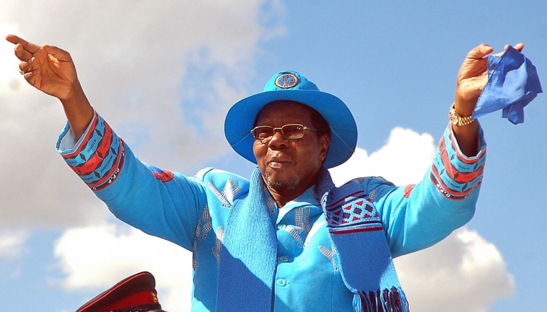 <p>President Bingu wa Mutharika, seen here waving to supporters during a campaign rally for the 2009 elections which he went on to win, has expelled Britain's ambassador after he described Malawi's leader as