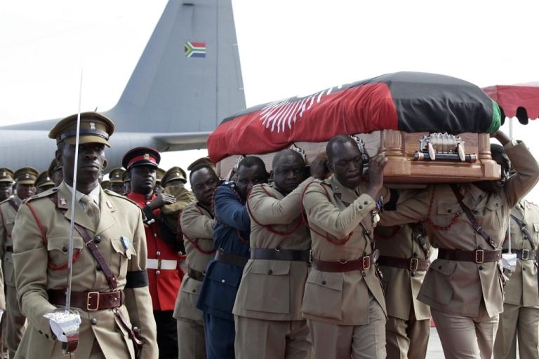 <p>Malawi pallbearers carry the casket with the remains of Malawi's late President Bingu wa Mutharika at Kamuzu International Airport in Lilongwe on April 14, 2012.</p>