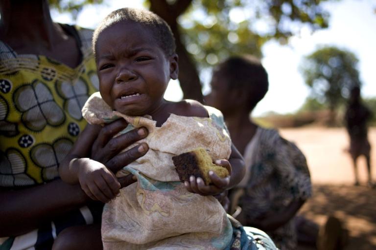 <p>Eneta Sam holds her sick granddaughter Gloria Napialo who is HIV positive, in Chakwindima Village, Malawi on June 5, 2011.</p>
