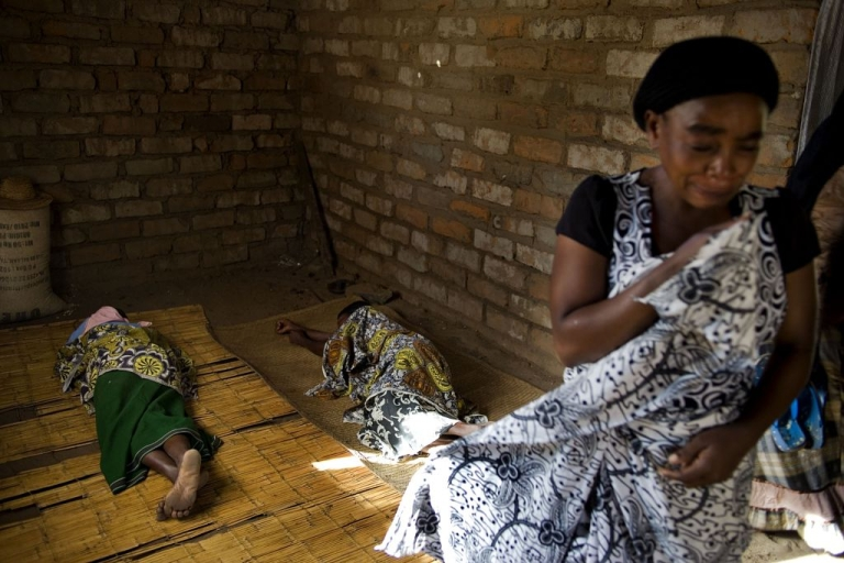 <p>Family members look for comfort while grieving the death of their loved one, Aliyatu Alola, 24, who arrived at the Salima District Hospital dead along with her unborn child in Salima, Malawi on June 3, 2011.</p>