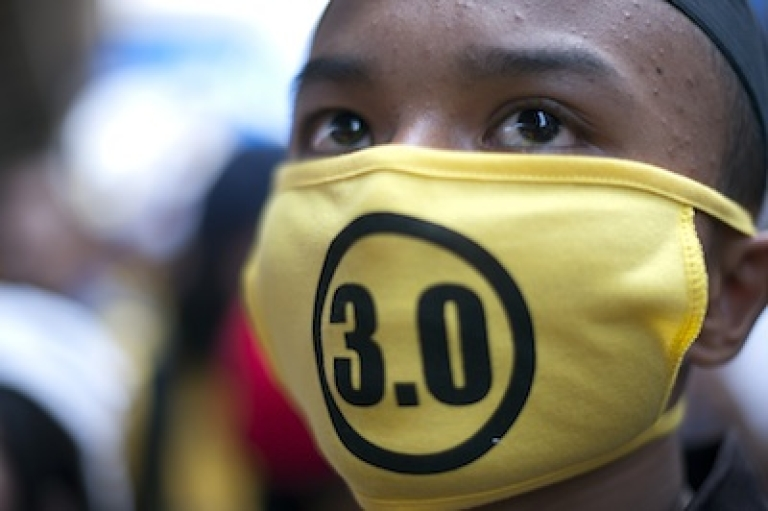 <p>A protestor attends an anti-government rally while wearing Bersih 3.0 mask near the historical Merdeka Square in Kuala Lumpur on April 28, 2012. Thousands of protesters gathered in the Malaysian capital to demand electoral reforms, defying a lockdown of central Kuala Lumpur that left it a maze of razor wire and barricades.</p>