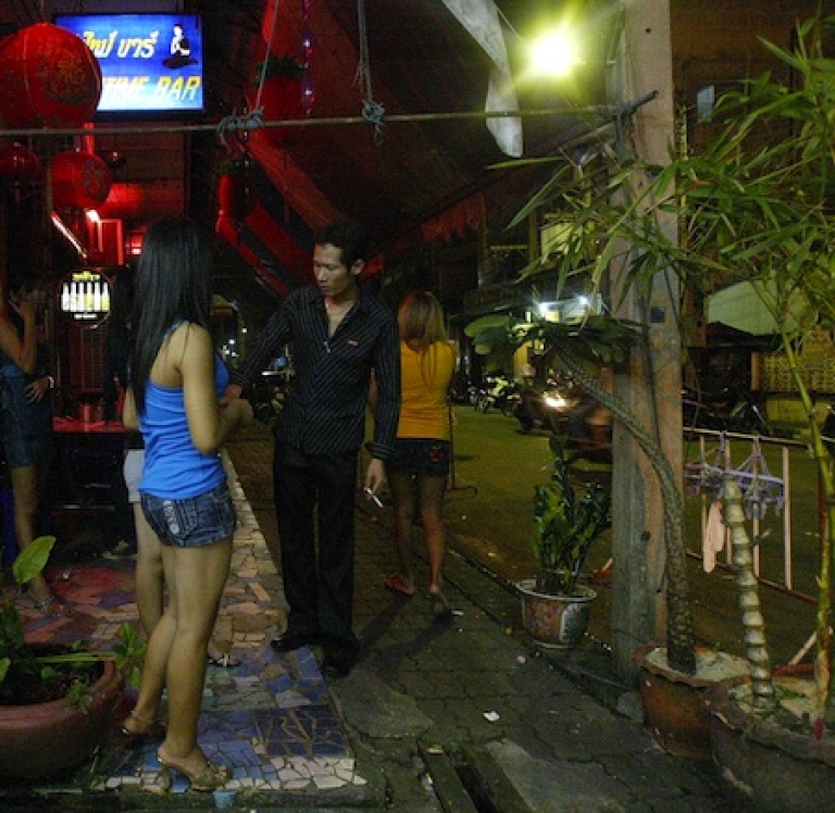 <p>Sex workers and bar patrons in the Thai-Malay border town of Sungai Kolok.</p>