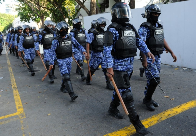 <p>Maldivian policemen patrol the streets during clashes with anti-government protestors in the capital island Male on Feb. 8, 2012. The demonstrators were supporting former president Mohamed Nasheed who stepped down a day earlier.</p>