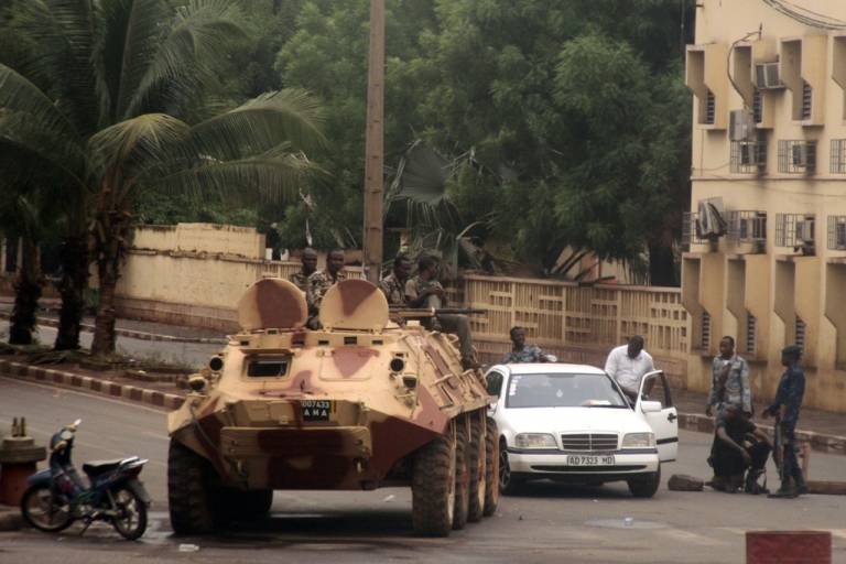 <p>Mali soldiers loyal to Captain Amadou Sanogo sit on an armored vehicle in Bamako near Mali's radio station ORTM, on May 1, 2012. Sanogo said his troops were in control of the capital's airport, the state TV and radio station and the Kati army barracks following clashes with loyalists of ousted President Amadou Toumani Toure.</p>