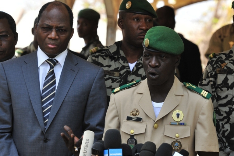 <p>Malian junta leader captain Amadou Sanogo speaks next to Burkina Faso's Foreign Minister Djibrill Bassole during a declaration at the Kati military camp near Bamako on April 1, 2012. Sanogo announced the reinstatement of the constitution and state institutions Sunday, and promised broad consultation on a political transition.</p>