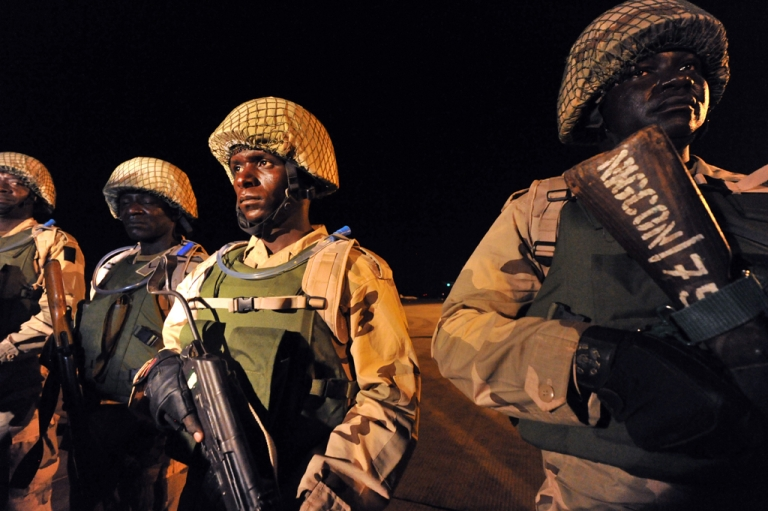 <p>Nigerian soldiers arrive at the airport in Bamako, Mali, on January 17, 2013. Nigerian and Togolese soldiers were posted as part of the West African force meant to help French troops chase Islamists from their strongholds in northern Mali.</p>