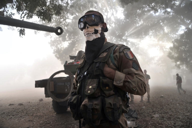 <p>A French foreign legion soldier wearing a skeleton mask in Niono. Human rights activists allege Mali's army has killed dozens of people in reprisal attacks and ethnic murders.</p>