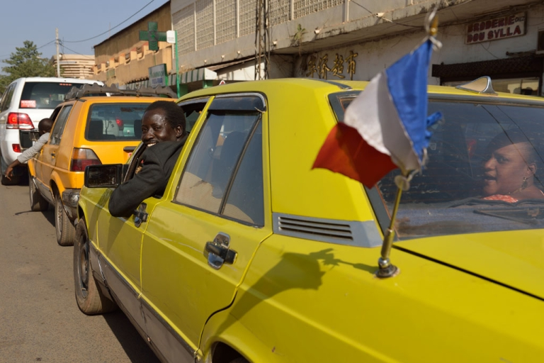 <p>A Malian taxi driver displays a French flag on his car on January 17, 2013 in Bamako.</p>