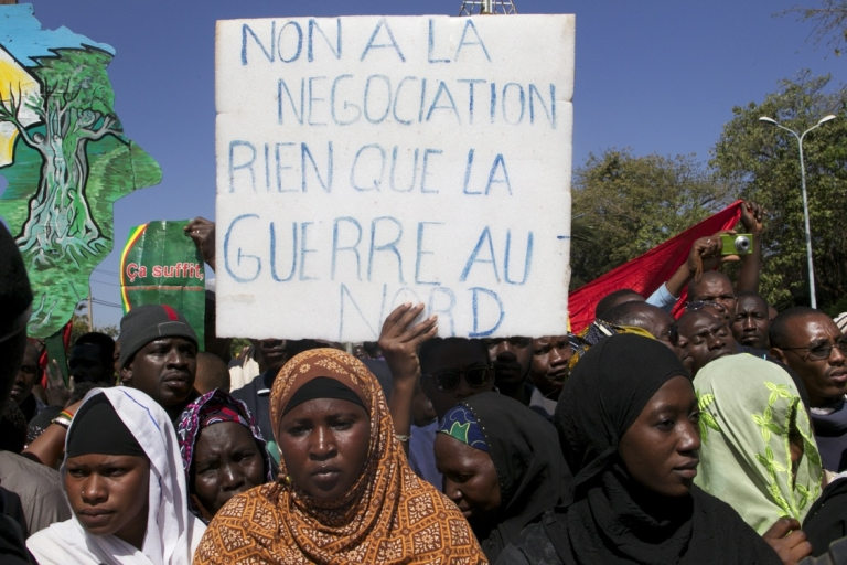 <p>A man holds a banner that reads 'No to negotiation, only war in the north' as thousands of Malians gather in Bamako on December 8, 2012 for a demonstration to support the Malian army and demand a UN Security Council resolution approving the deployment of an international force in the country's north, controlled for several months by Islamist armed groups.</p>