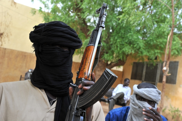 <p>Fighters of the Islamist group Movement for Unity and Jihad in West Africa in the courtyard of the Islamist police station in Gao, in July 2012.</p>