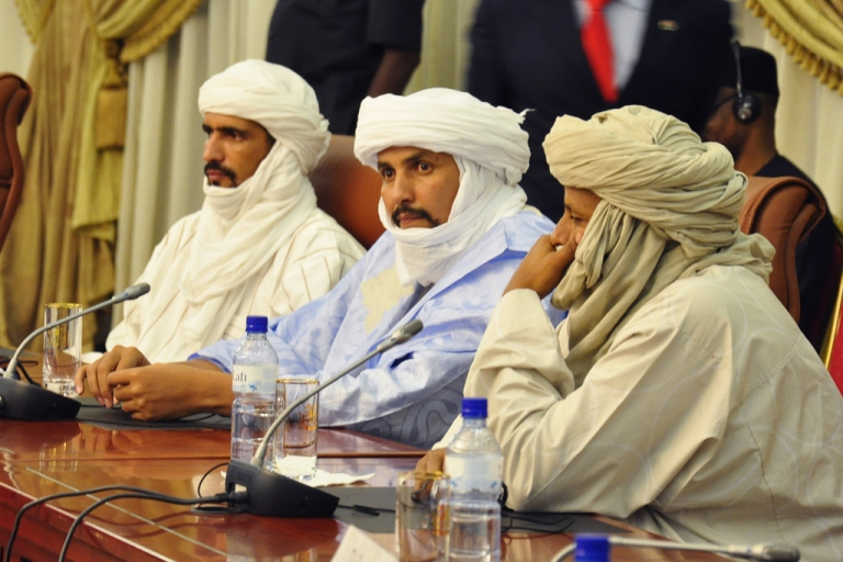 <p>Algabass Ag Intalla (C), leader of the Ansar Dine delegation, attends a mediation meeting with members of the Malian government and the Azawad National Liberation Movement (MNLA) Tuareg rebellion, hosted by the Burkina Faso President, in Ouagadougou, on December 4, 2012. The Islamist extremists have moved even closer to government-held areas as of January 8, 2013.</p>