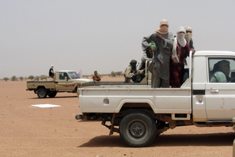 <p>This photo taken on August 7, 2012, shows fighters from the Islamic group Ansar Dine in Kidal, northeast Mali. One of the group's top leaders has formed his own faction and called for a ceasefire between rebels and the Malian government.</p>