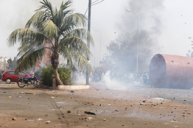 <p>A picture taken on February 22, 2012 shows smoke rising on a street during clashes between relatives and supporters of soldiers fighting rebels Tuareg in the north during a protest against the