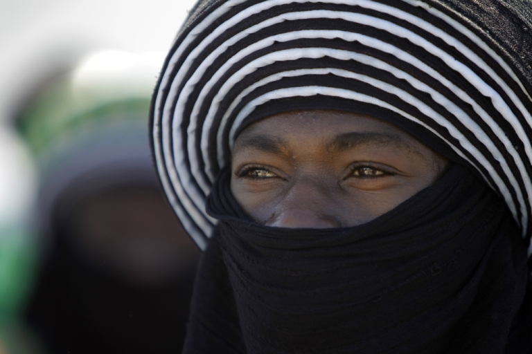 <p>A Tuareg tribesman is photographed here during a welcome ceremony for the African Union delegation at the airport in Tripoli, Libya, on April 10, 2011.</p>