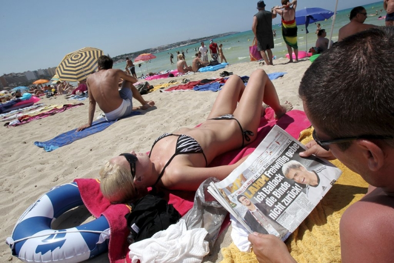 <p>Germany may have a great economy but Spain has great beaches as this German tourist in Mallorca would probably be willing to admit.</p>