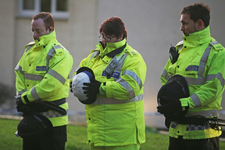 <p>Police officers pay their respects as the body of a female officer leaves the scene in Manchester where two female officers were shot today on September 18, 2012. Dale Cregan, 29, has been arrested in connection with the shooting of Nicola Hughes and Fiona Bone.</p>