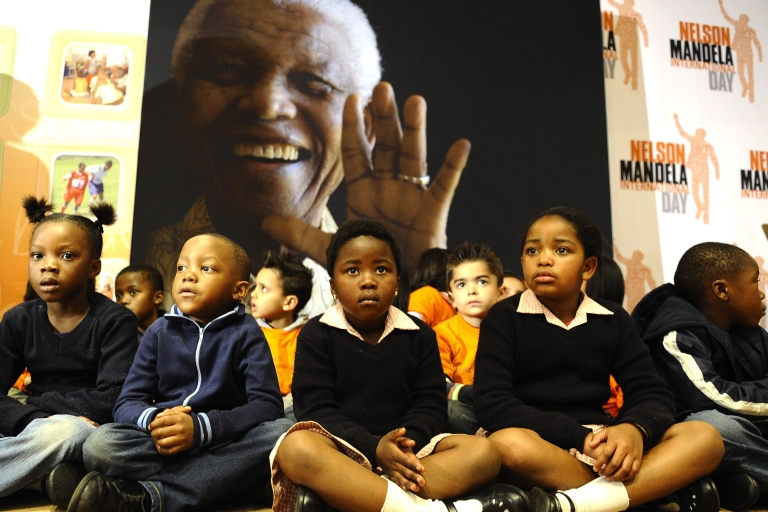<p>A group of schoolchildren participate in a symbolic handover on July 17, 2011 at the Nelson Mandela Foundation in Johannesburg to set the tone before the Mandela's 93rd birthday and Mandela Day on July 18, 2011.</p>