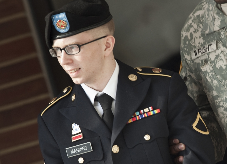 <p>Private First Class Bradley Manning is escorted following a motions hearing in his trial at Fort Meade on March 15 in Maryland.</p>