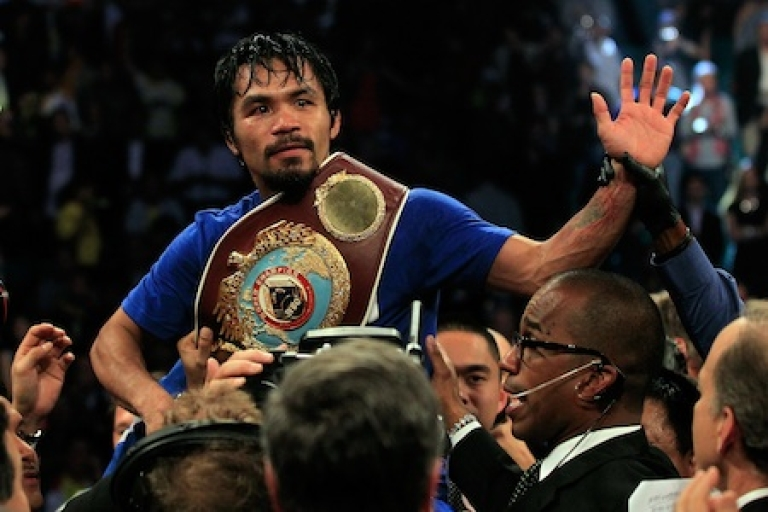 <p>Manny Pacquiao of the Philippines celebrates after his unanimous decision victory against Shane Mosley in the WBO welterweight title fight at MGM Grand Garden Arena on May 7, 2011 in Las Vegas, Nevada.</p>