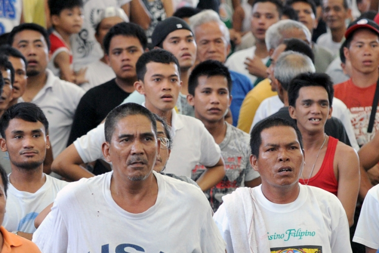 <p>Filipino spectators watch a TV broadcast in stunned silence as boxer Manny Pacquiao loses to Juan Miguel Marquez on December 9, 2012, in Las Vegas.</p>
