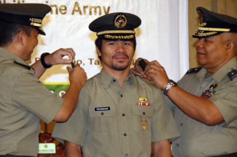 <p>Boxer and Congressman Manny Pacquiao is promoted to lieutenant colonel in the Philippine Army.</p>