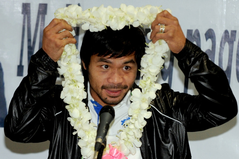<p>Philippine boxing icon Manny Pacquiao prepares to speak to supporters at Manila's international airport on December 12, 2012, upon his return from the United States and a loss to Mexican Juan Manuel Marquez.</p>