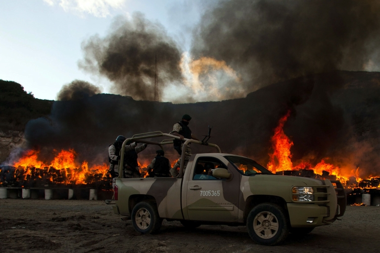 <p>Mexican soldiers check the burning of 134 tonnes of marijuana on October 20, 2010 in the border town of Tijuana, Mexico, seized by the Mexican Army after a clash with drug traffickers. It was then one of the biggest confiscations in recent years.</p>