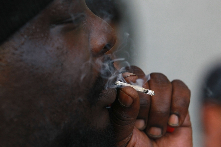 <p>Medical marijuana patient Kirk Anderson smokes marijuana during a protest outside of the State of California building on July 18, 2011 in San Francisco,</p>